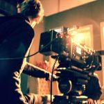cameraman-holding-a-camera-camera-crew-film-camera-N9FQ2SU