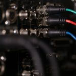 RGB video cables in the rear panel of the professional VCR. XLR audio cables in blur.